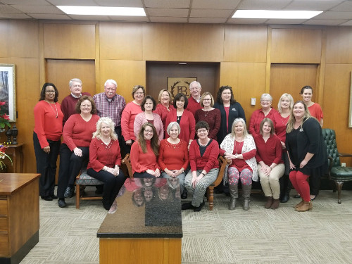 Bank of LaFayette employees shown wearing red clothing to celebrate National Wear Red for Heart Health Day.